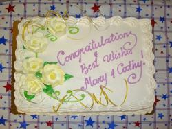 white with light yellow flowers Retirement cake.jpg
