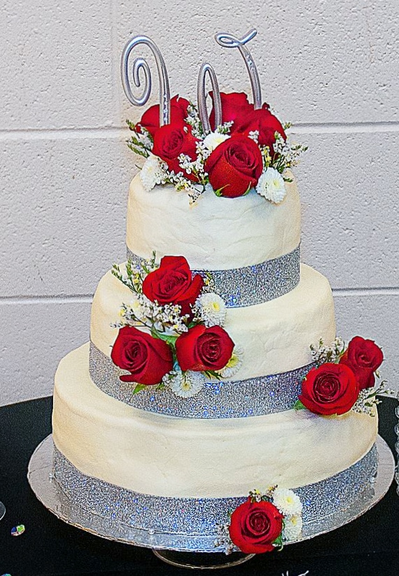 3 tier white wedding cake with fresh red roses and silver monogram topper.JPG