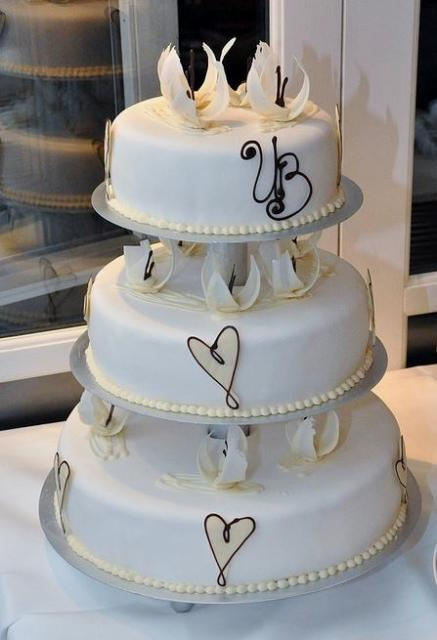 3 Tier Round White Wedding Cake With Columns Between Layers And White Chocolate FlowersJPG