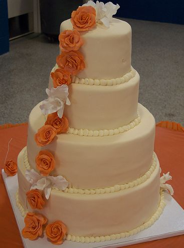 orange and white wedding cakes 4 tier ivory wedding cake with orange and white flowers 18042