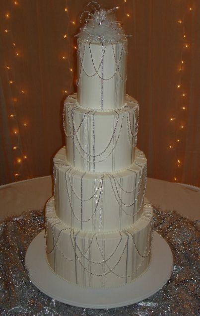 Four Tier Wedding Cake With Bead Strings Jpg