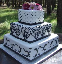 Three tier square wedding cake with black patterns and fresh flowers topping.JPG