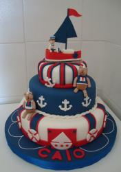 Nautical theme 3 tier cake with kid on sailboat on top and teddy bear sailors.JPG