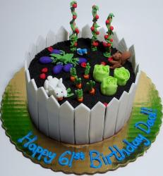 Vegetable and flower garden cake with white fence.JPG