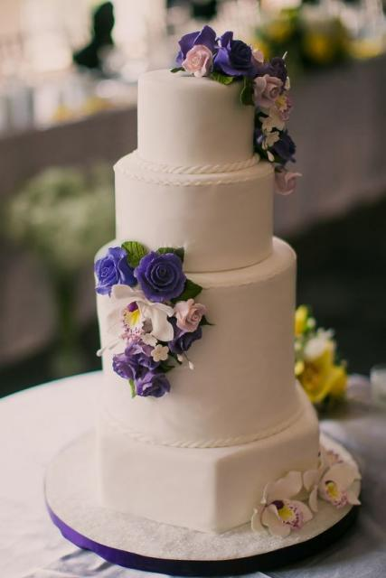white wedding cakes with purple flowers 4 tier white wedding cake with hexagonal base tier and 27396