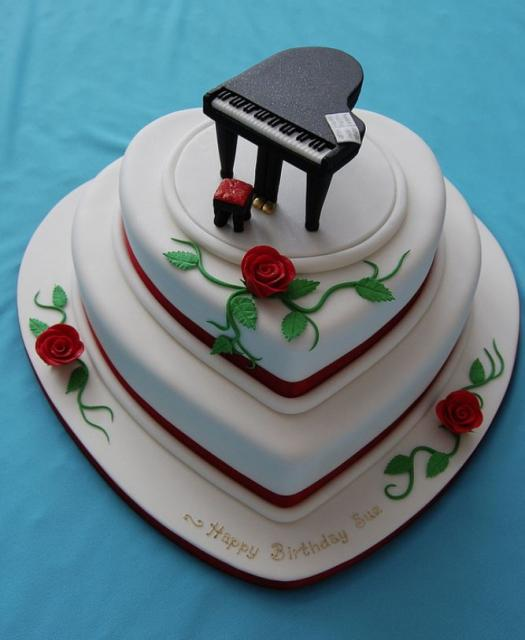 3 tier heart-shaped birthday cake with roses and black ...