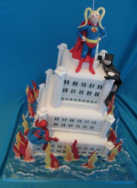 Supergirl batman and spiderman climbing building cake.JPG