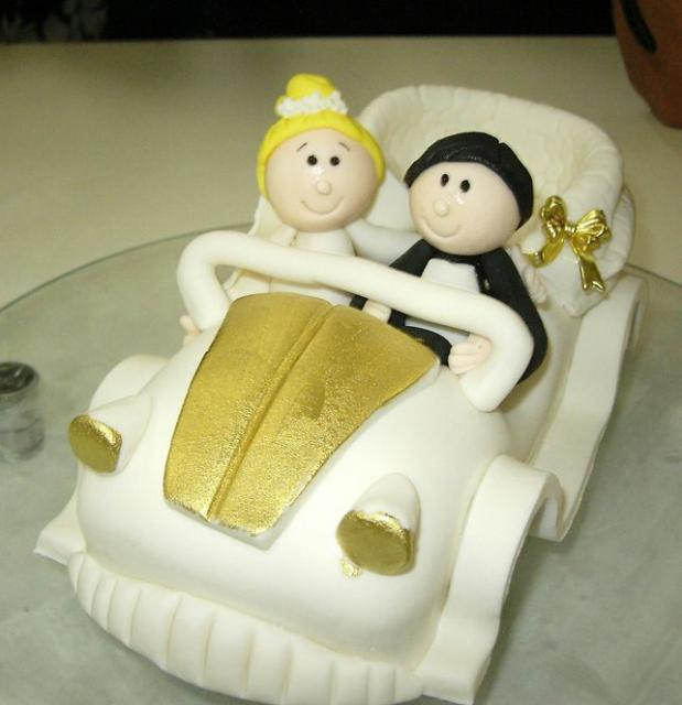 Bride and Groom in a buggy wedding cake topper.JPG