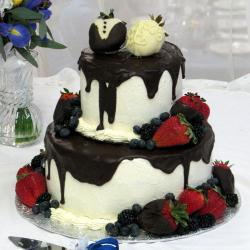 Chocolate and strawberry wedding cake with blueberries.JPG