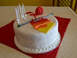 Knitting theme round white birthday cake.JPG