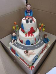 3 tier running race theme cake with winner sitting on top.JPG
