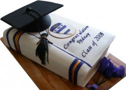 Graduation cake with book and cap.JPG