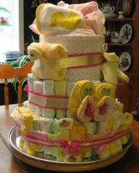 Baby shower cake made out of diapers and slippers.JPG