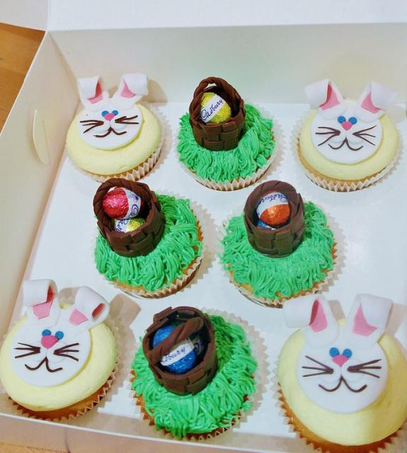 Easter theme cupcakes with rabbit faces and easter egg basket toppers.JPG