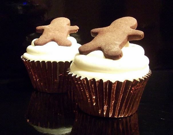 Gingerbread man on top of white cream cupcake.JPG