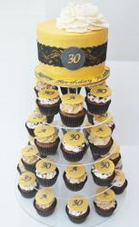 Thirtieth birthday yellow cake with sheer fabric with 4 cupcake levels underneath.JPG