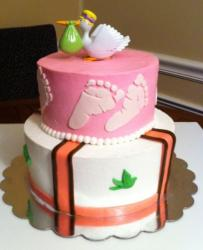 2 tier baby shower cake with stork delivering baby on top.JPG