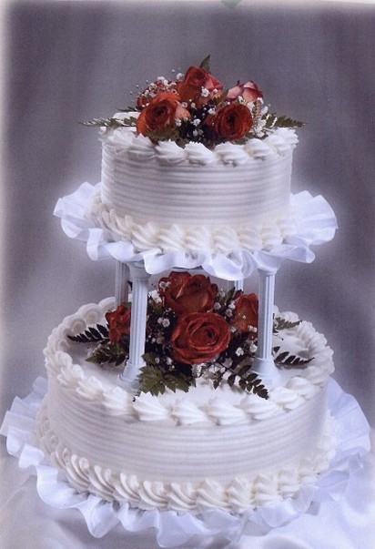 Two tier white wedding cake with red flowers pictures mightylinksfo