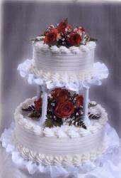 Two tier white wedding cake with red flowers pictures