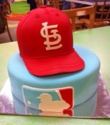 St Louis Cardinals cake with red baseball cap on top.JPG