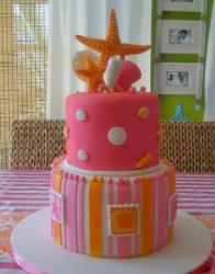 Two tier birthday cake with starfish.JPG