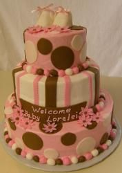 3-tier baby shower cake with baby slippers.JPG