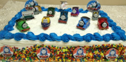 Large Thomas birthday cake with  Thomas and friends crew.PNG