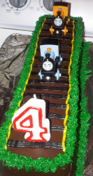 Train track birthday cake with trains running_4th birthday cakes pictures.PNG