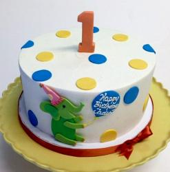 Round white first birthday cake with Green Elephant.JPG