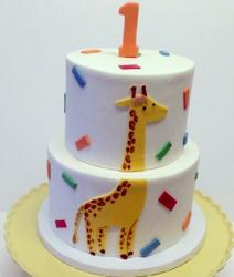 Round 2 tier first birthday cake with giraffe.JPG