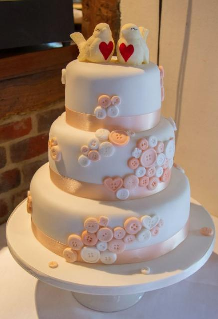 Triple Level Round White Wedding Cake With Buttons And