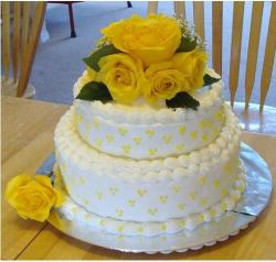25th Anniversary Cake with bright yellow roses.jpg