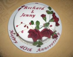 40th wedding anniversary cake in white with dark red roses.jpg