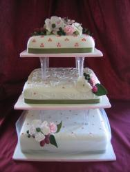 a 50th anniversary cake with fresh flowers.jpg