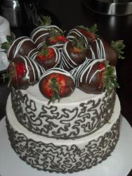 Anniversary cake with chocolate covered strawberries.jpg