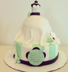 Bridal shower cake with wedding dress on top.JPG