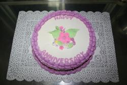 anniversary cakes with floral topper.jpg