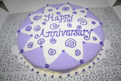 best anniversary cakes in puruple and white.jpg