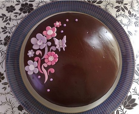 Chocolate anniversary cake with pink and purple flowers.jpg