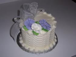 first anniversary cakes with purple and white flowers.jpg