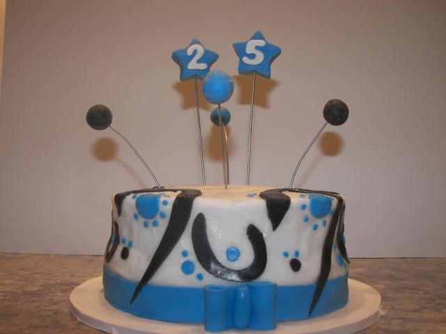 fun 25th anniversary cake in white, blue and black.jpg