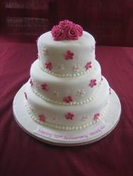 Three 50th Anniversary Cake with pink flowers picture.jpg