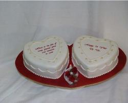 Two heart shaped anniversary cakes in white.jpg