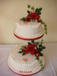 wedding anniversary cake decorations with red flowers.jpg