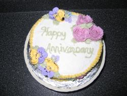 wedding anniversary cake with colorful flowers.jpg