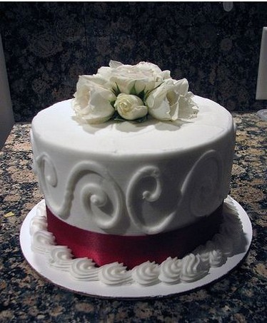 White anniversary cake with white roses.jpg