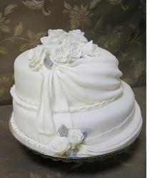 white elegant 25th Anniversary cake with white floral topper.jpg