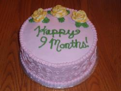 9 Month Anniversary Cake in purple with yellow roses.jpg