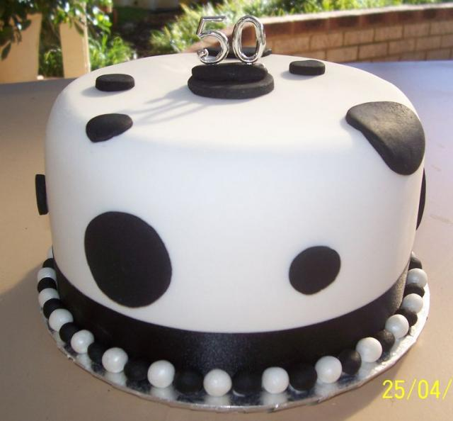Fiftieth birthday cake in white and black with pearls.JPG