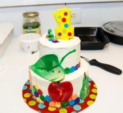 Birthday cake for 1 year old with worm and green leaf in 2 tiers.JPG